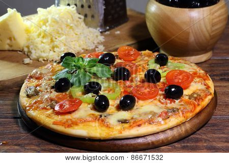 Pizza With Mushrooms, Olives, The Bulgarian Pepper, Rucola And The Fused Cheese