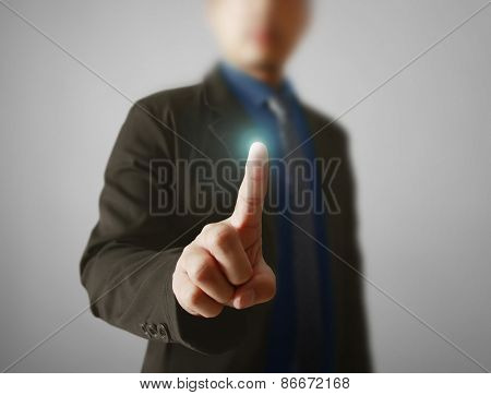 Man hand pushing on a touch screen interface