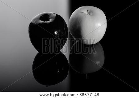 Black Apple And White Apple.