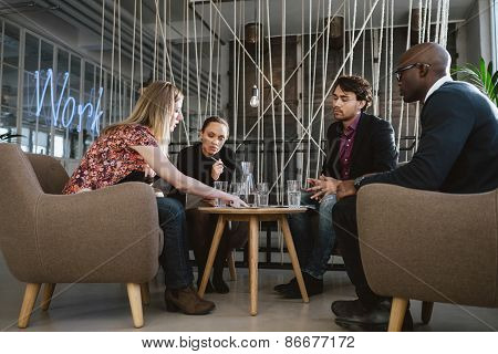 Diverse Group Of Executives Discussing Business