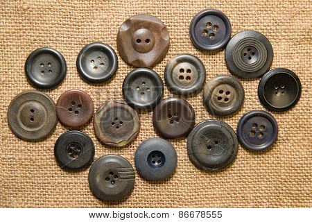 A Lot Of Vintage  Buttons  On The Old Cloth