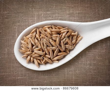 Rye In White Porcelain Spoon / High-res Photo Of Grain In White Porcelain Spoon On Burlap Sackcloth