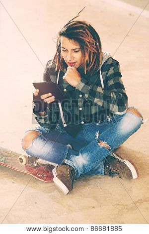 Dreadlocks  Guy Sitting With Digital Tablet Warm Filter Applied
