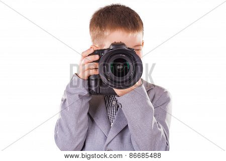 kid holding a dslr camera isolated on the white