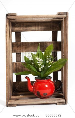 Lilies of the valley in a wooden crate