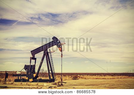Retro Filtered Picture Of Oil Pump Jack, Texas, Usa.