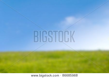 Grassy Hill In Springtime With Blue Sky - Background Blur