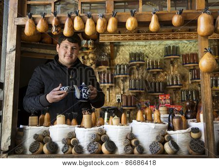 BUKHARA, UZBEKISTAN - MARCH 16, 2015: Tea shop. A man sells tea and herbs.