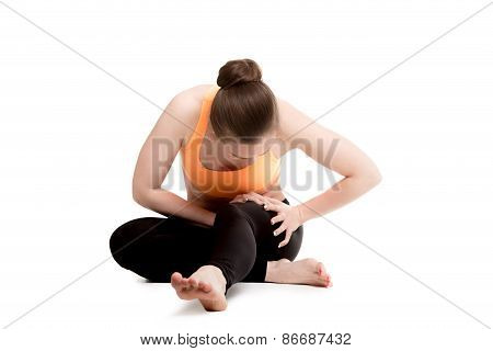 Young Female Athlete Touching Injured Thigh