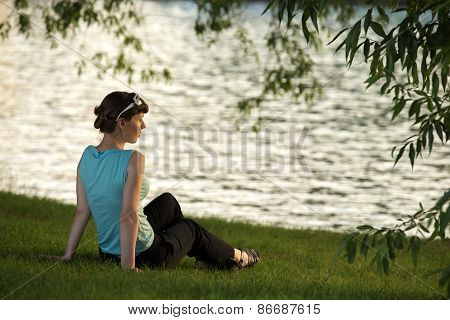 Young Woman Resting On The Riverside