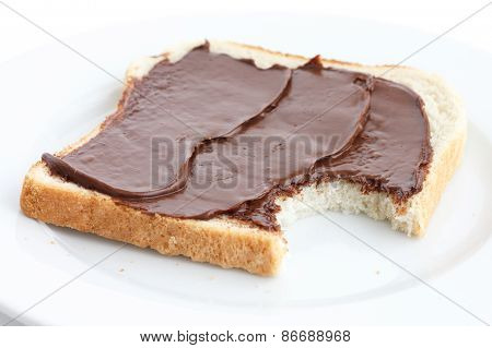 Chocolate spread on white sliced bread.