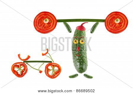 Little Funny Cucumber Raises The Bar Next To It Stands  A Bicycle