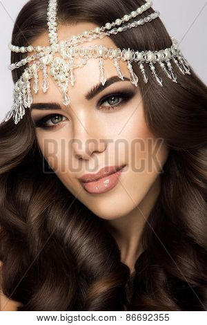 Beautiful bride with wedding makeup and hairstyle, attractive newlywed woman have final preparation