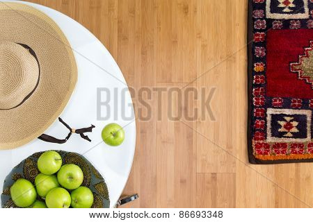 Fresh Green Apples On The Table With Brown Hat