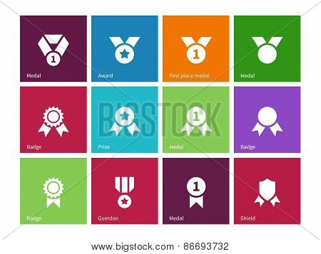 Cup and medal icons on color background.