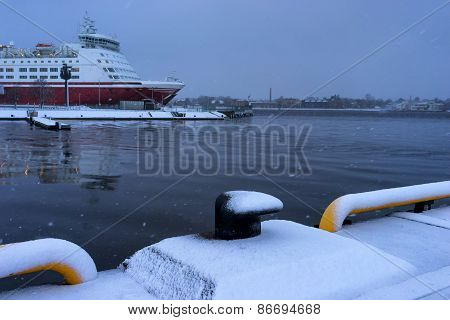 Passenger Ferry At The Pier In The Snow In The Winter