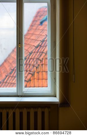 Tiled Roofs Of The Window Blinds Lines And Heating Radiators