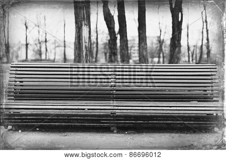 Long bench in the rainy Park