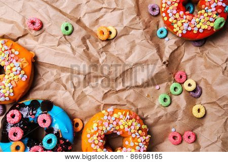 Colorful donuts on a wrinkled paper