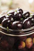 stock photo of kalamata olives  - jar with pickled kalamata olives - JPG