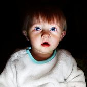 stock photo of scared baby  - Scared Child Boy Portrait in the Dark Room - JPG