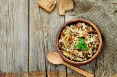 foto of porridge  - barley porridge with mushrooms on a dark wood background - JPG