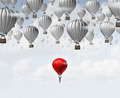 stock photo of joining  - Late career as a businessman in a red hot air balloon trailing and falling behind a group of competitors as a business concept for catching up and job aspirations to join an organization - JPG