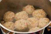 picture of boil  - Dumplings in a boiling pot - JPG
