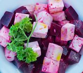 foto of beet  - beet salad in bowl and on a table - JPG