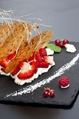 foto of collate  - Biscuit Chantilly cream and red fruits on a plate - JPG