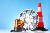 image of alloy  - shiny alloy wheel with road emergency items - JPG