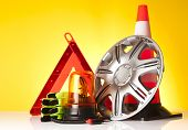 foto of rectifier  - warning triangle and car service accessories on yellow background  - JPG
