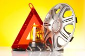stock photo of rectifier  - car accessories and road emergency items n yellow background - JPG