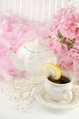 foto of special day  - A vintage feminine tea party still life with a teapot set hot tea with lemon and fresh cut pink roses perfect for Mothers Day Easter or special occasion - JPG