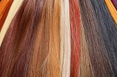 stock photo of auburn  - Artificial Hair Used for Production of Wigs and Extensions - JPG