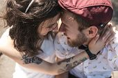 picture of heterosexual couple  - beautiful couple embraced and gently rubs noses - JPG