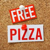 image of bribery  - The words Free Pizza in cut out magazine letters pinned to a cork notice board as an incentive - JPG