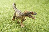 foto of dinosaur  - Close up Isolated dinosaur on grass background - JPG