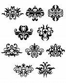 foto of flourish  - Flourish design elements in damask style showing black curly abstract flowers isolated on white background suitable for wallpaper or invitation design - JPG