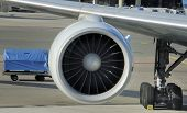 picture of rotor plane  - engine of passenger airplane waiting in airport at platform  - JPG