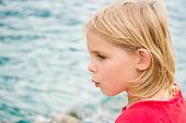 picture of coy  - Pretty Little Blonde Girl Whistling by the Lake - JPG