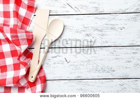 Empty Wooden Table With Wooden Spoon And Napkin On White Background
