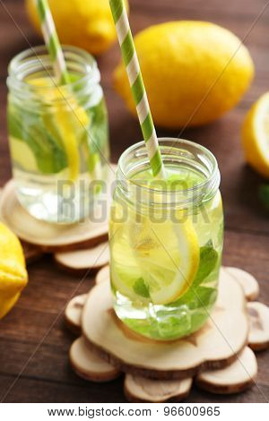Fresh Lemonade With Lemon On Brown Wooden Background