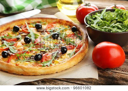 Fresh Tasty Pizza On Brown Wooden Background