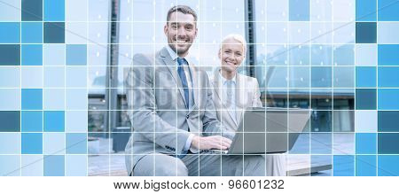 business, education, technology and people concept - smiling businesspeople working with laptop computer on city street over blue squared grid background