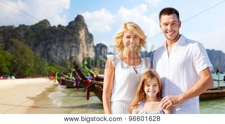 summer holidays, travel, tourism, children and people concept - happy family over beach in thailand or bali background