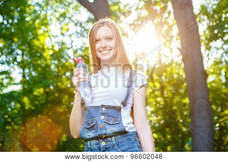 Beautiful smiling red-haired young woman