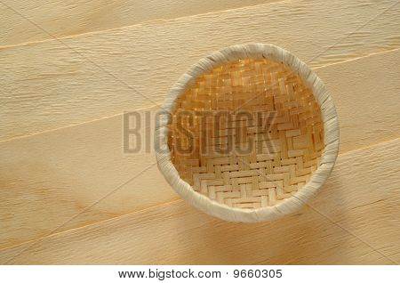 Bamboo basket on wood pieces