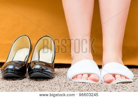 Female Feet Shod In Comfortable Slippers Closeup