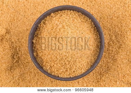 Brown Sugar In Dark Bowl
